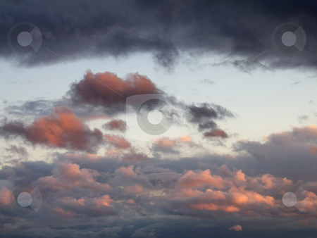 After the Storm stock photo, Light from the setting sun reflecting off of cumulus clouds that appeared when the dark nimbostratus clouds began to break apart. by Kathy Piper