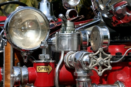 Old Fire Truck stock photo, Close up of an old fire truck. by Henrik Lehnerer
