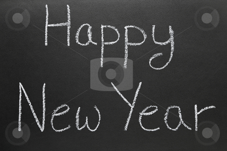 Happy New Year written on a school blackboard. stock photo, Happy New Year written on a school blackboard. by Stephen Rees