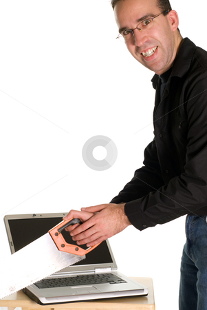 Computer Crash stock photo, A man cutting his computer in half, isolated against a white background by Richard Nelson