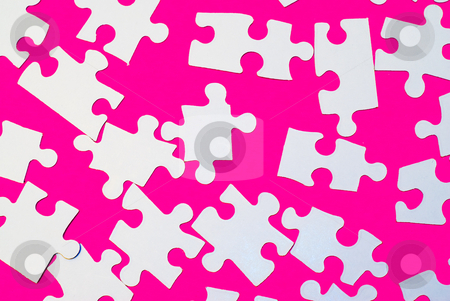 Puzzle Pieces On Pink stock photo, White puzzle pieces shot on a pink background by Richard Nelson
