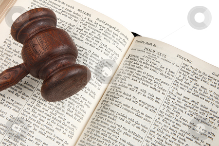 Close up of a wooden judge's gavel on an 1882 bible. stock photo, Close up of a wooden judge's gavel on an 1882 bible. by Stephen Rees