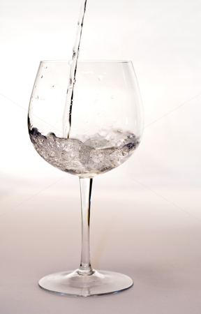 Pouring Water stock photo, Watre being poured into a wine glass by Richard Nelson