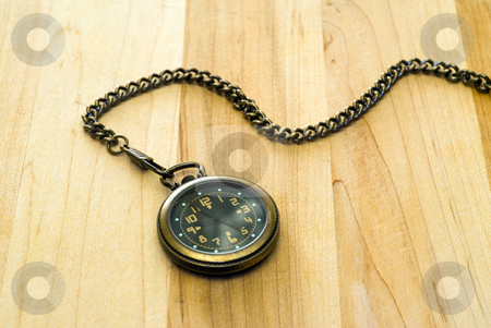 Antique Pocket Watch stock photo, An antique pocket watch shot on a wooden table by Richard Nelson