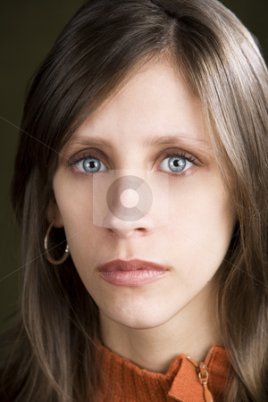 Expressionless Young Woman stock photo, Pretty young woman with a blank expression on her face by Scott Griessel