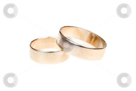 Wedding rings stock photo, Gold wedding rings isolated on white background with shade by Marek Kosmal