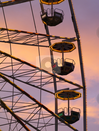 Big wheel stock photo, A ferris wheels gondolas at dusk by Torsten Lorenz
