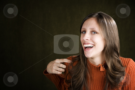 Young Woman Laughing stock photo, Young woman in an orange sweater laughing by Scott Griessel