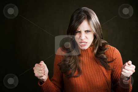 Frustrated Young Woman stock photo, Frustrated Young Woman in an Orange Sweater by Scott Griessel