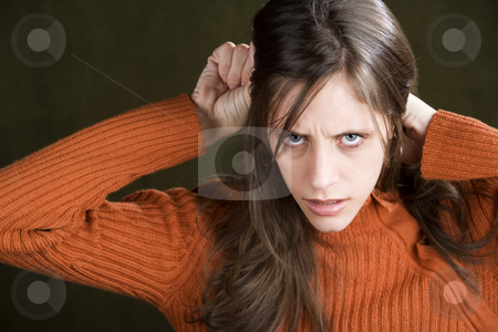 Distraught Young Woman stock photo, Distraught Young Woman in an Orange Sweater by Scott Griessel