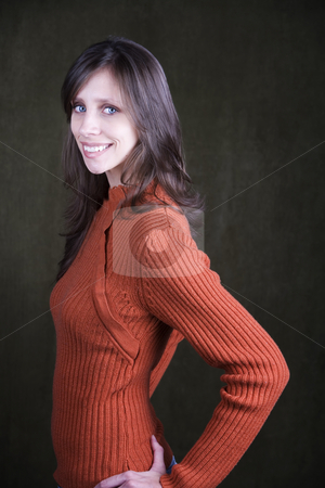 Pretty Young Woman stock photo, Pretty Young Woman Wearing an Orange Sweater by Scott Griessel