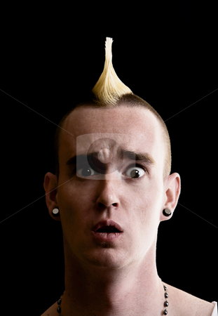 Man with Mohawk stock photo, Confused Man with a Tall Yellow Mohawk by Scott Griessel