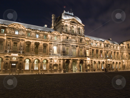 The Louvre Palace by night stock photo, Paris,France, Europe, December, 2008 - Facade of the Louvre Palace by night. The Louvre Palace (Palais du Louvre) which houses the museum was begun as a fortress built in the 12th century under Philip II. by FEL Yannick