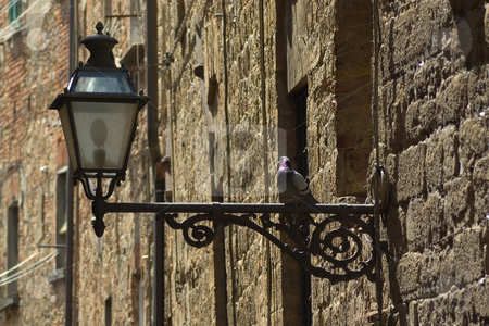 Laterne an einer Hauswand - Lantern at the wall stock photo, An einer Hauswand in Volterra, Toskana - At the wall in the city of volterra, tuscany, italy by Wolfgang Heidasch