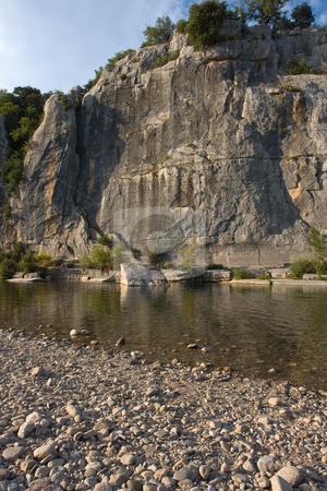 Cliffs and riverbed in Chassezac, Ardeche Valley, Southern France stock photo, Der Chassezac ist ein Zufluss der Ard?che in S?dfrankreich. Er entspringt in den Cevennen in der N?he von Le Moure de la Gardille. Bei Ruoms m?ndet er in die Ard?che. Typisch ist das steile Tal, welcher in den Jahrtausenden in den Stein gegraben hat. Fluss und Tal sind heute ein Eldorado f?r Kletterer und Kanufahrer. by Wolfgang Heidasch