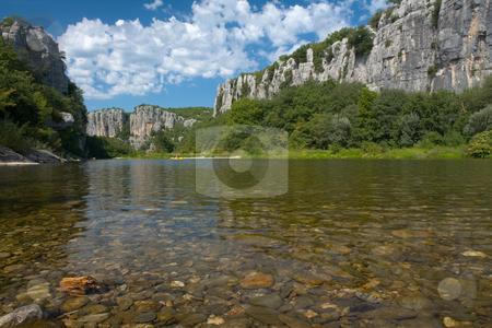 Body of water and Cliffs in Chassezac, Ardeche Valley stock photo, Der Chassezac ist ein Zufluss der Ard?che in S?dfrankreich. Er entspringt in den Cevennen in der N?he von Le Moure de la Gardille. Bei Ruoms m?ndet er in die Ard?che. Typisch ist das steile Tal, welcher in den Jahrtausenden in den Stein gegraben hat. Fluss und Tal sind heute ein Eldorado f?r Kletterer und Kanufahrer. by Wolfgang Heidasch