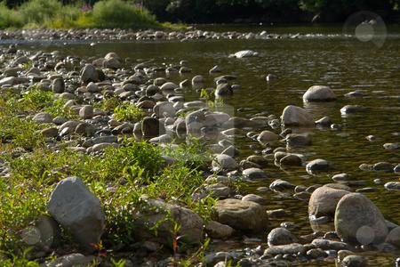 Riverbed in Chassezac, Ardeche Valley, Southern France stock photo, Der Chassezac ist ein Zufluss der Ard?che in S?dfrankreich. Er entspringt in den Cevennen in der N?he von Le Moure de la Gardille. Bei Ruoms m?ndet er in die Ard?che. Typisch ist das steile Tal, welcher in den Jahrtausenden in den Stein gegraben hat. Fluss und Tal sind heute ein Eldorado f?r Kletterer und Kanufahrer. by Wolfgang Heidasch