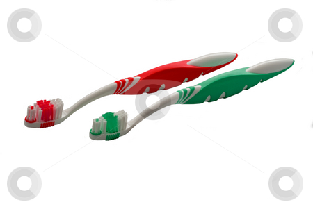 Toothbrushes stock photo, A pair of toothbrushes on a white background by Peter Soderstrom