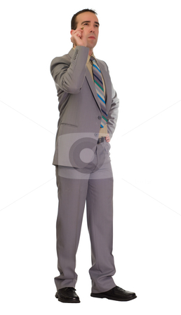 Businessman Throwing Darts stock photo, Full body view of a young businessman throwing a dart, isolated against a white background by Richard Nelson
