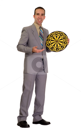 Bullseye stock photo, Full body view of a businessman wearing a grey suit holding a dartboard with a bullseye by Richard Nelson