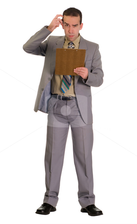 Confused Employee stock photo, Full body view of an employee scratching his head and looking confused by Richard Nelson