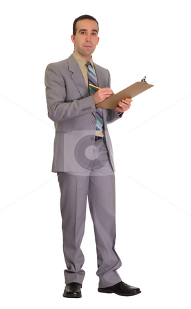Businessman With Clipboard stock photo, Full body view of a businessman holding a clipboard and a pencil by Richard Nelson