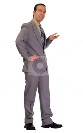 Waiting Businessman stock photo, Full body view of a businessman patiently waiting and holding his pocket watch by Richard Nelson