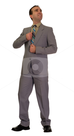 Promotion stock photo, A young businessman looking happy with himself at his new promotion by Richard Nelson