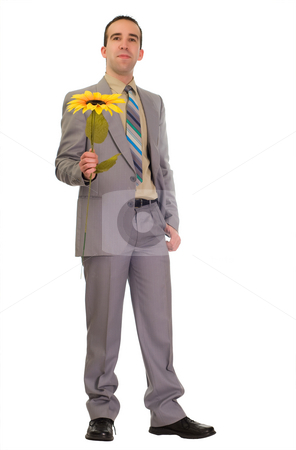 Poor Businessman Gives Fake Flower stock photo, Full body view of a businessman holding a fake flower because he is too poor to buy real ones in a bad economy by Richard Nelson