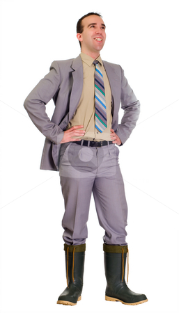 Overcoming The Odds stock photo, Concept image of a businessman doing well in the market even if he had to walk through some deep water by Richard Nelson