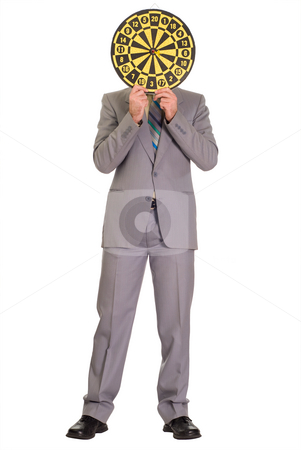 Businessman Hiding Behind Dartboard stock photo, Full body view of a businessman hiding his face behind a dartboard by Richard Nelson