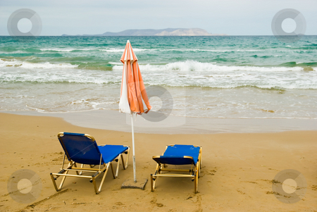 Umbrella and chairs stock photo, Chairs and umbrella on beach by Dariusz Majgier