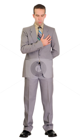 Isolated Man At Funeral stock photo, Full body view of a man wearing a suit paying his respect at a funeral, isolated against a white background by Richard Nelson