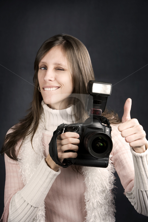 Thumbs Up From a Pretty Photographer stock photo, Pretty photographer with a professional camera and flash gives Thumbs Up by Scott Griessel
