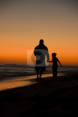 Dad and Daughter stock photo, Father and Daughter walking along the beach at sunset by A Cotton Photo