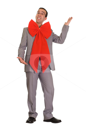 Christmas Businessman stock photo, Young businessman giving himself away as a Christmas present by Richard Nelson
