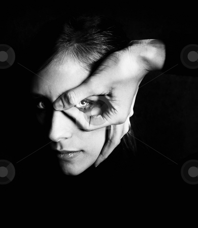 Model with dark makeup circling her eye stock photo, Model wearing dark makeup with hand in front of her eye by Scott Griessel