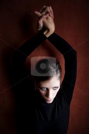 Beautiful Woman in a Black Dress stock photo, Beautiful Woman with in black hands above her head by Scott Griessel