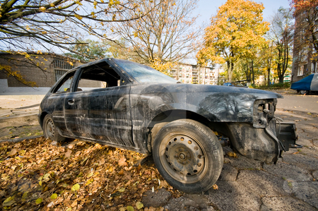 Wrecked car stock photo, Old wrecked car on the street. by Dariusz Majgier