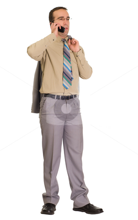 Man Talking On Cell stock photo, Full body view of a man talking on his cell phone by Richard Nelson
