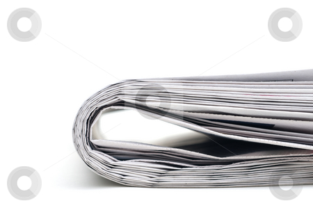Closeup of a newspaper stock photo, Closeup of the end of a folded newspaper by Vince Clements
