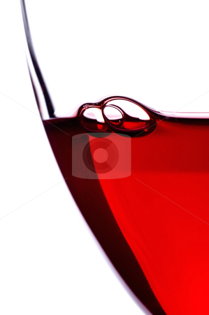 Wine glass and bubbles stock photo, Macro of bubbles in a glass of red wine by Vince Clements
