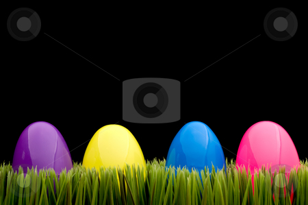 Colored eggs on grass stock photo, Colored eggs on grass with a black background by Vince Clements