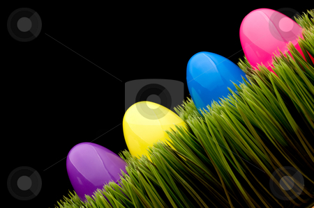 Colored eggs on grass stock photo, Colored eggs on grass with a black bacground - tilted by Vince Clements