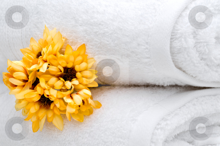 Flowers and white towels stock photo, Yellow flowers and white towels by Vince Clements