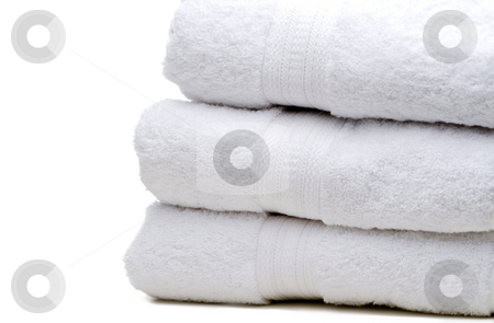 A stack of white towels stock photo, A stack of white towels on white by Vince Clements