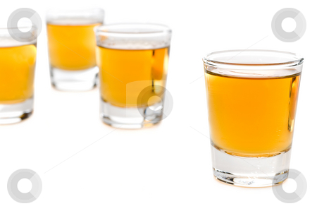 Shot glasses of whiskey stock photo, Shot glasses of whiskey by Vince Clements