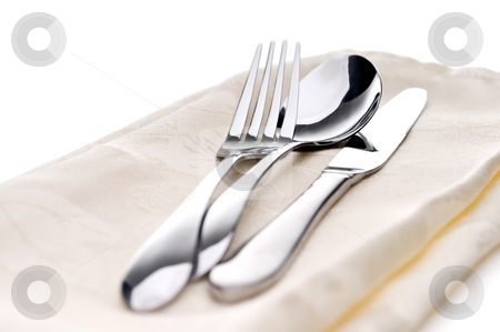 Silverware on a napkin stock photo, Silverware on a napkin by Vince Clements