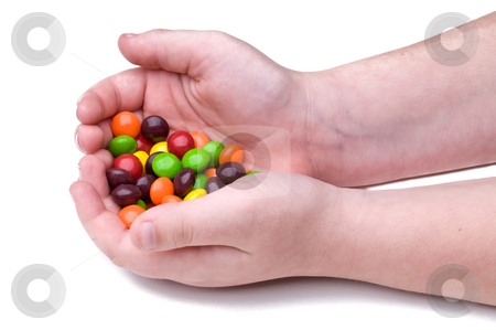 Child holding candy stock photo, A child's cupped hands holding candy by Vince Clements
