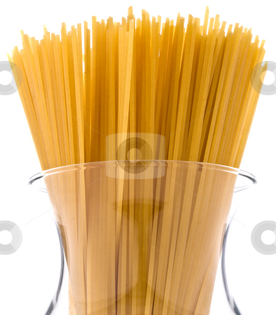 A bundle of spaghetti in a jar stock photo, A bundle of spaghetti in a glass jar on white by Vince Clements
